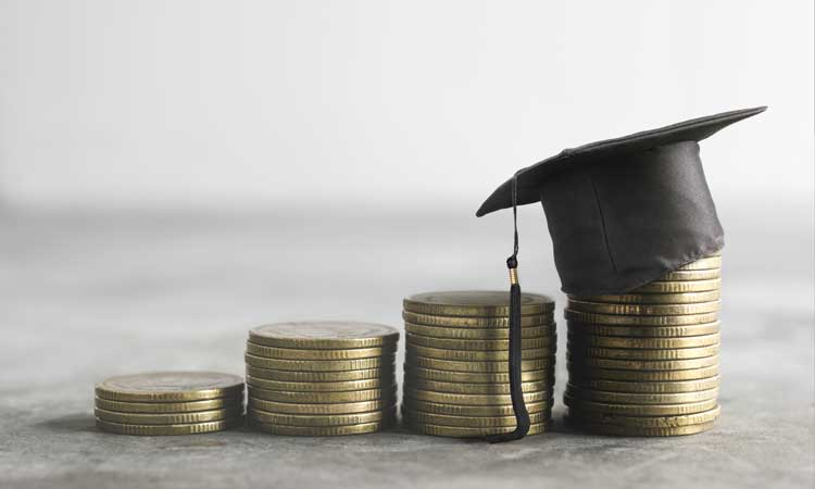 stack of coins and a graduate's cap