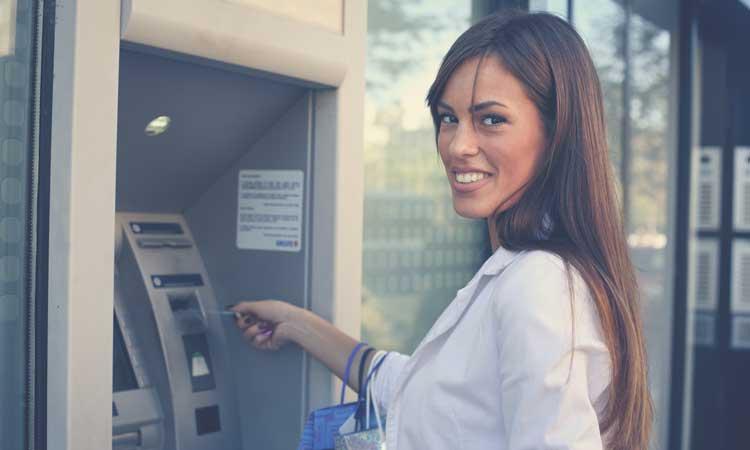 woman using a debit card
