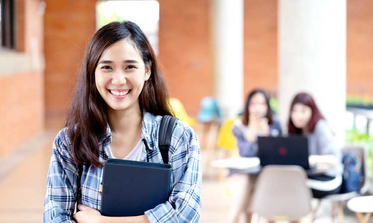 Smiling female college student